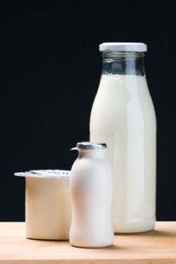 11225787 - milk bottle, yogurt and probiotic drink yogurt in vertical composition.black background